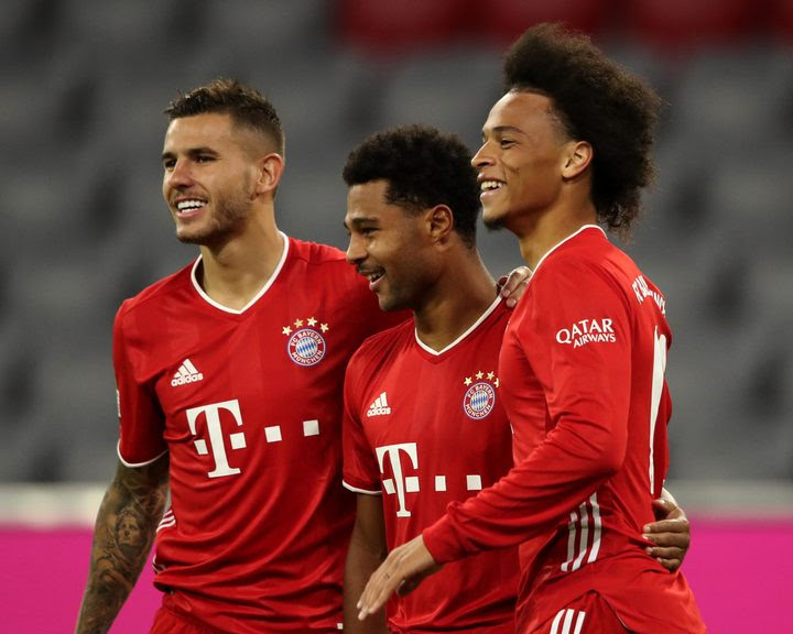 Serge Gnabry (c.) scored his first Bundesliga hat-trick, while Leroy Sane (r.) marked his Bayern Munich debut with a goal against his former club Schalke.